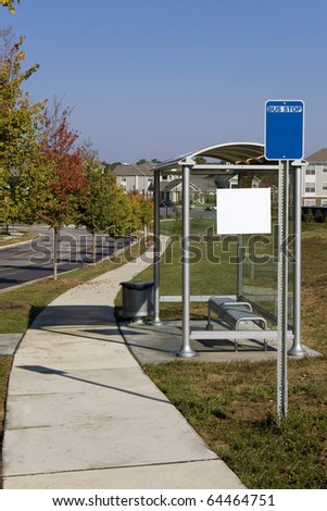 Glass Bus stop in suburban area - stock photo