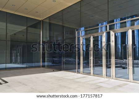 Glass closed doors of the entrance in modern building - stock photo