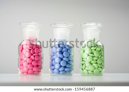 glass container with tablets - stock photo