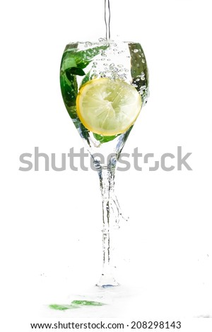 Glass cup filled with cold fresh water. - stock photo