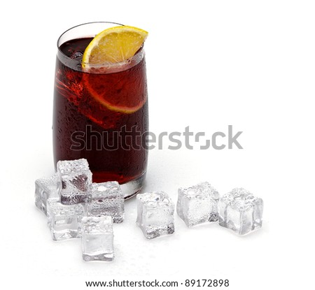 glass cup filled with fresh tasty sangria with lemon and ice - stock photo