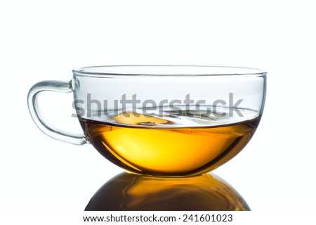 Glass cup of black tea. Isolated on white background - stock photo