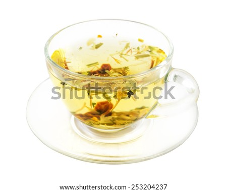 Glass cup of herbal Alpine tea isolated on white with clipping path - stock photo