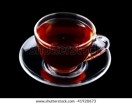 Glass cup of tea isolated on black - stock photo