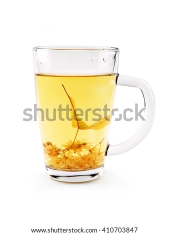 Glass cup of tea with lime dry blossom isolated on white. Linden decoction. - stock photo