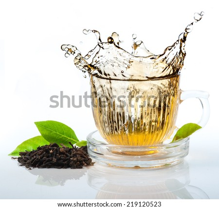 glass cup of tea withsplash out - stock photo