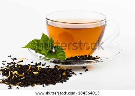 Glass Cup Tea with camomile flower and Mint Leaf, on white - stock photo