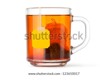 Glass cup with teabag. Isolated on a white. - stock photo