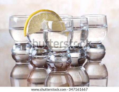 Glass cup with tequila on table      - stock photo