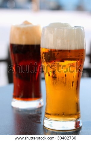 Glass dark and light of beer - stock photo