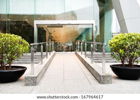 Glass door of modern office building. - stock photo