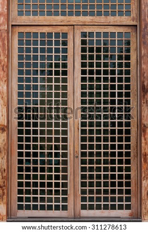 Glass door with wooden frame - stock photo