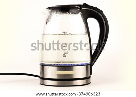 glass electric kettle with boiling water, isolated on white / Electric kettle isolated on white background close up / electric teapot kettle with a boiling water inside and color  isolated in white  - stock photo