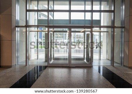 Glass entrance to new modern business centre - stock photo