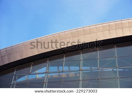 glass exterior of a modern office building - stock photo