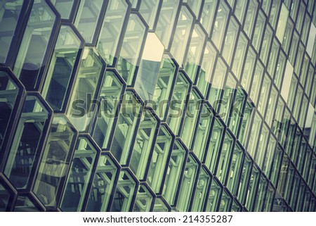 Glass facade with reflection of abstract building - stock photo