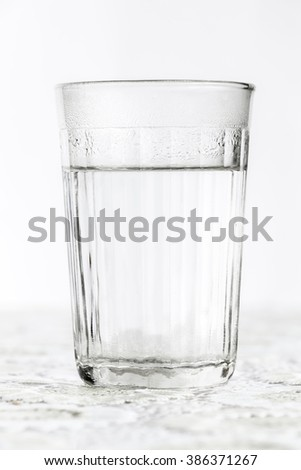 Glass faceted glass with boiling water - stock photo