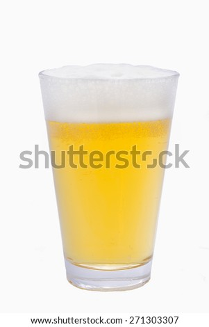 Glass filled with ale and a  layer of froth - stock photo