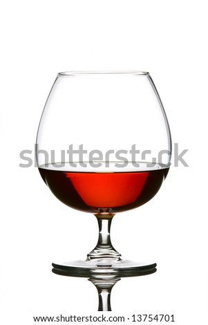 Glass filled with brandy over white background - stock photo