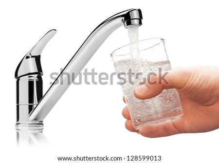 Glass filled with drinking water from tap, isolated on the white background. - stock photo