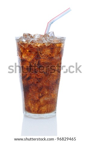 Glass filled with ice cubes and Cola soda over a white background. Glass is covered with condensation . - stock photo
