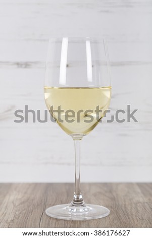 Glass filled with White Wine - stock photo