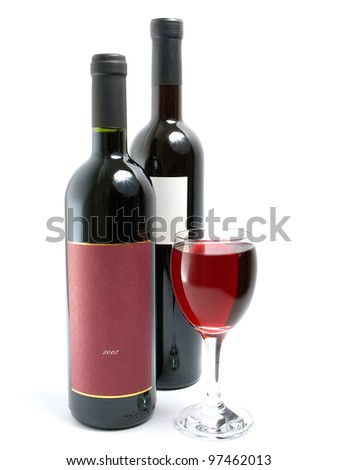 Glass full of red wine and two bottles of wine on a white background. - stock photo