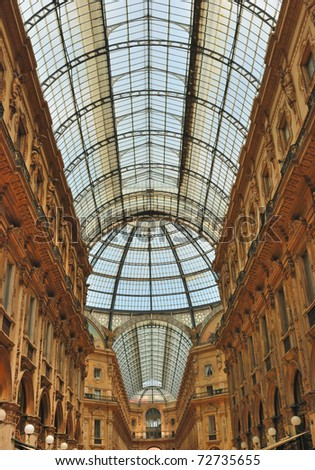 Glass gallery - Galleria Vittorio Emanuele in Milan of Italy - stock photo