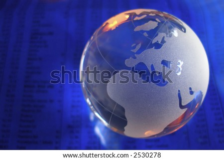 glass globe in front of business numbers - stock photo