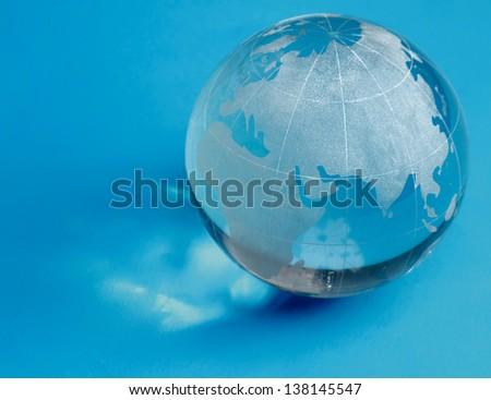 glass globe, isolated on blue background - stock photo