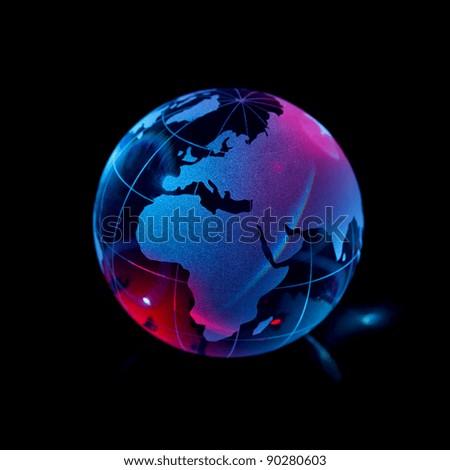 Glass globe on a black background - stock photo
