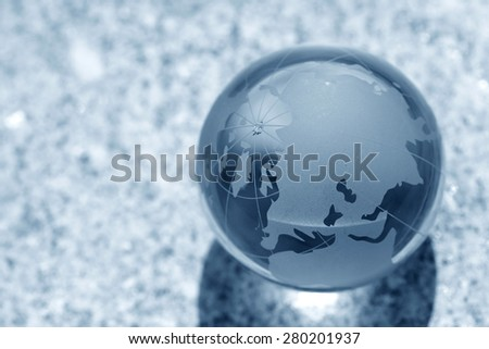 glass globe on water - stock photo