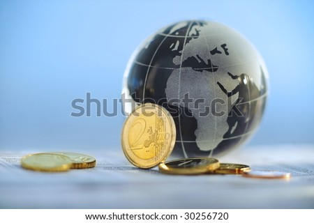Glass globe with Europe and Africa showing and Euros - stock photo