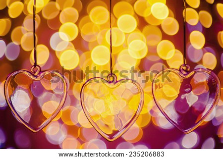 Glass heart decoration selective focus on abstract defocused light background, Pentax-M 50 1.7. - stock photo