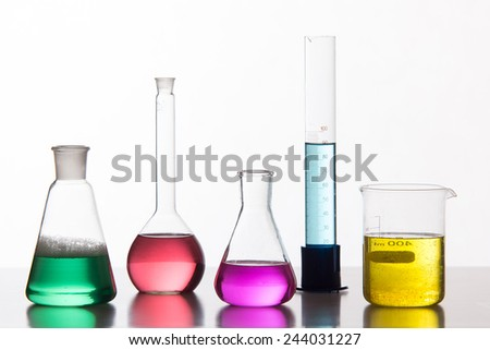 Glass in a chemical laboratory filled with colored liquid - studio shoot - stock photo