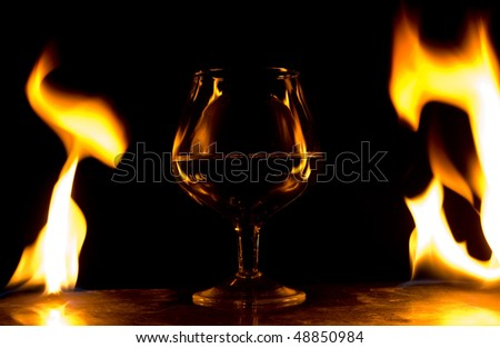 Glass in fire flames - stock photo
