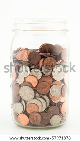 Glass Jar almost Filled with Various Coins - stock photo