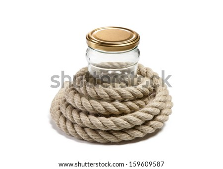 Glass jar and Coil of rope on isolated background - stock photo