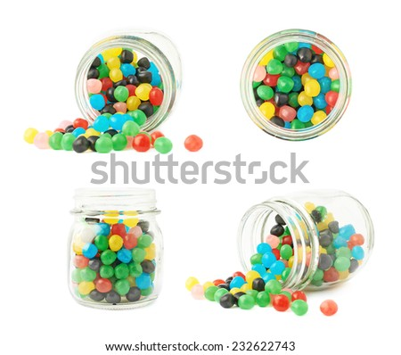 Glass jar full of colorful candy ball sweets, composition isolated over the white background, set of four different foreshortenings - stock photo