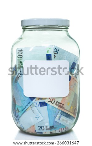 Glass jar full of Euro currency with a label on it for copy space - stock photo