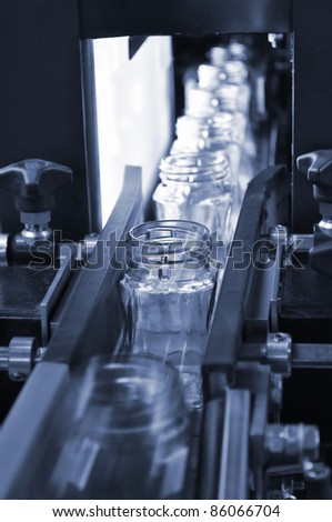 Glass jar inspection line - stock photo