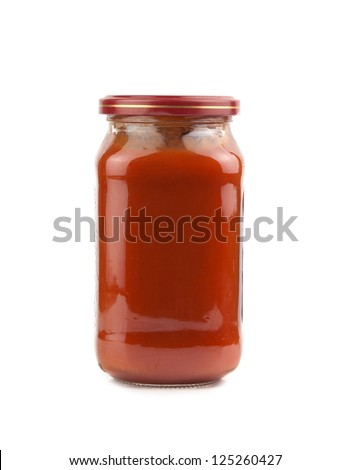 glass jar of hot tomato sauce on a white background - stock photo