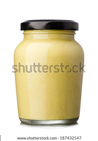 Glass jar of mustard isolated on the white background - stock photo