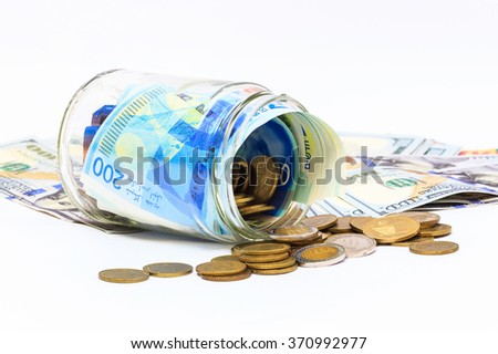 glass jar of pile of New Israeli Shekels banknotes with the new 200 NIS - stock photo