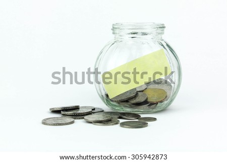 Glass jar with coins, isolated - savings concept - stock photo