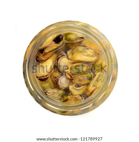 Glass jar with conserved mussels - stock photo
