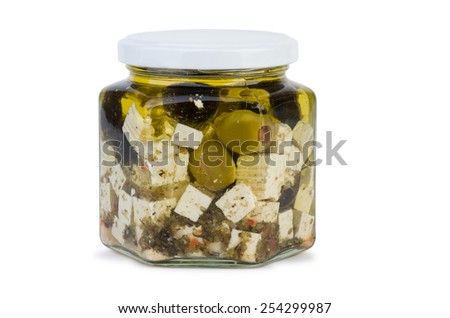 Glass jar with fitaki cheese in oil and olives over the white background - stock photo
