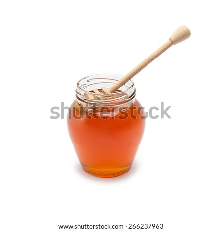 glass jar with honey dipper on white background - stock photo