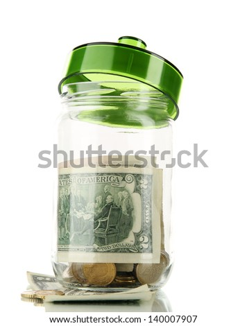 Glass jar with money isolated on white - stock photo