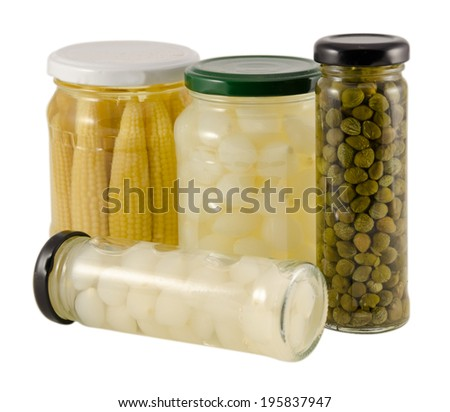 glass jar with pickled spice vegetables in vinegar isolated on white background  - stock photo